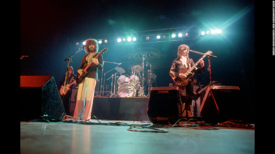 "At first, rock music was a hobby for MIT grad Tom Scholz, left, who worked for the Poloroid camera company before turning his passion into a profession. By 1976, Scholz's band, Boston, had released its debut album with singer Brad Delp (center), drummer Jim Masdea and guitarist Barry Goudreau (right). Their best-known hits include ""More Than a Feeling,"" ""Don't Look Back"" and ""Amanda."" With only seven albums in its catalog, the band has sold an amazing 31 million units in the US, according to the Recording Industry Association of America."