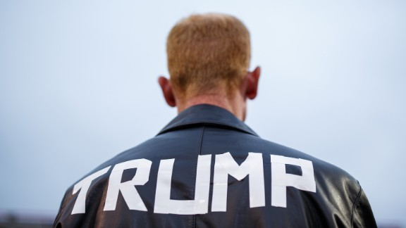 "A man in a homemade Donald Trump jacket attends a rally at Ladd-Peebles Stadium in Mobile, Alabama, on Saturday, December 17. It was the final stop on the President-elect's ""Thank You"" tour. Photographer Melissa Golden covered the event on assignment for CNN."