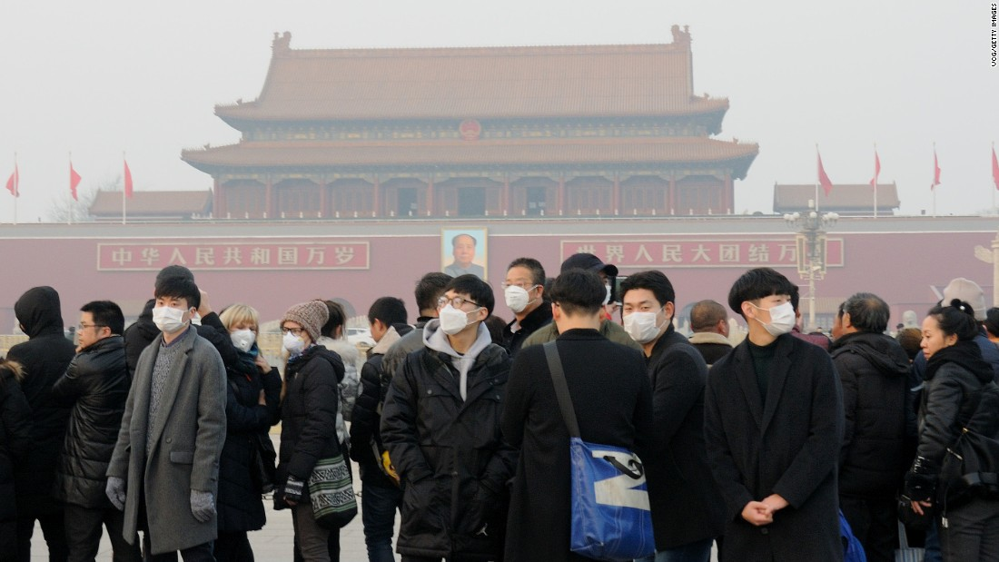 Tourists visit Tiananmen Square in Beijing on Sunday, December 18.