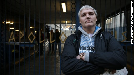 Homeless man Quentin Sheridan stands outside the office block taken over by activists in Dublin.