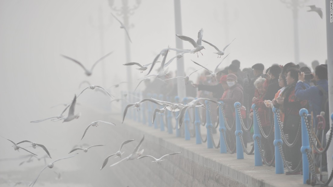 Tourists visit the Zhan Qiao, a wharf in Qingdao, China, on December 19.