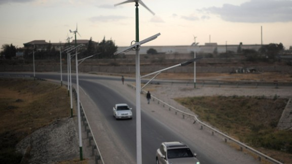 Street lamps powered by wind and solar energy line the side of a road close to the Kenyan capital Nairobi. Kenya is making a priority of wind, notably through the Lake Turkana Wind Power Project that will be the largest in Africa with a capacity of 310 MW.
