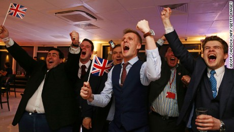 Leave.EU supporters wave Union flags and cheer as the Brexit results come in.