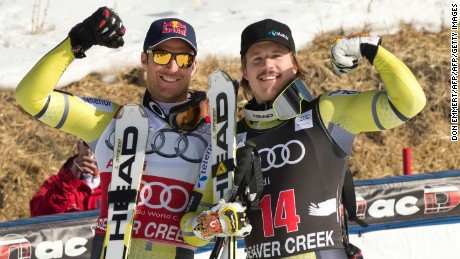 Patches of snow on the dry hill are seen behind Norwegians Aksel Lund Svindal (L), second, and Kjetil Jansrud, third, as they celebrate after the FIS Alpine World Cup Men's Downhill on November 30, 2012 in Beaver Creek, Colorado.     AFP PHOTO / DON EMMERT        (Photo credit should read DON EMMERT/AFP/Getty Images)