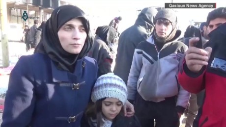 Fatemah Alabed with daughter Bana speaks to journalists about the evacuations from Aleppo.