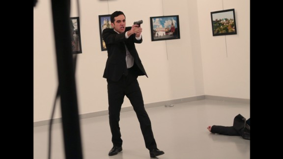 The man holds his gun up after shooting Karlov. The attack occurred at the Cagdas Sanat Merkezi modern arts center in Ankara. Turkish Interior Minister Suleyman Soylu said in a news conference that the gunman was Mevlut Mert Altintas, a Turkish police officer.