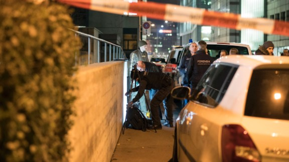 Police officers secure the area near an Islamic center in Zurich, Switzerland, after three people were shot there on Monday, December 19. A gunman, decked out in dark clothing, opened fire on a group of worshipers standing inside a prayer room, police said, citing eyewitnesses.