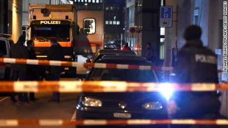 Swiss police are seen behind police cordon outside a Muslim prayer hall, central Zurich, on December 19, 2016, after three people were injured by gunfire.