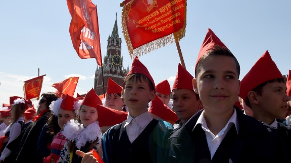 Children such as these belonging to the Young Pioneer youth communist group have grown up in a completely different country to that of their president.