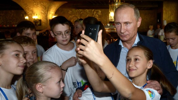 Russian President Vladimir Putin (R) poses for a photo during his visit to the National Children's Sports and Health Centre in Sochi on October 11, 2014. AFP PHOTO/RIA NOVOSTI/POOL/ALEKSEY NIKOLSKY        (Photo credit should read ALEKSEY NIKOLSKYI/AFP/Getty Images)