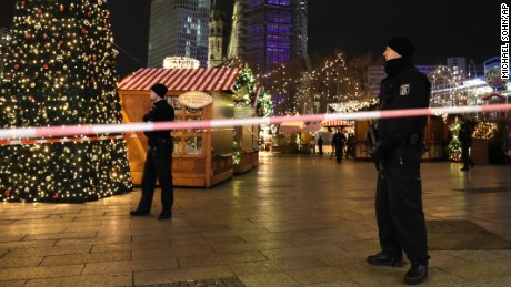 Police guard a Christmas market after a truck ran into the crowded Christmas market in Berliin Berlin, Germany, Monday, Dec. 19, 2016.