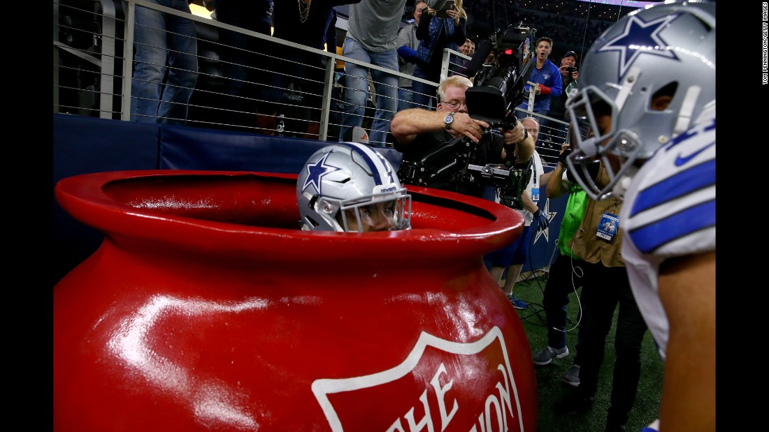 Dallas running back Ezekiel Elliott celebrates a touchdown by jumping into a big Salvation Army kettle on Sunday, December 18. Elliott rushed for a career-high 159 yards as the Cowboys beat Tampa Bay 26-20.