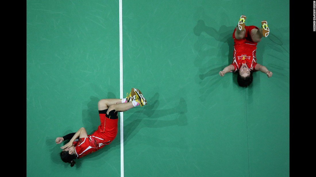 Chinese badminton players Chen Qingchen and Jia Yifan celebrate Sunday, December 18, after winning the Super Series doubles final in Dubai, United Arab Emirates.
