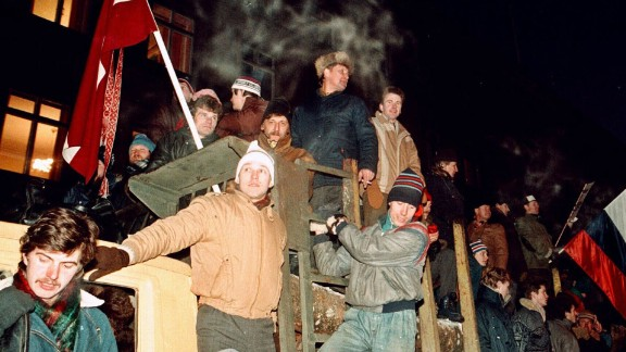 Civilians gather outside a government building barricaded against potential attack by Soviet troops in Riga, Latvia, on January 21, 1991.