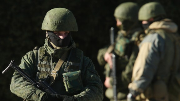 Armed men wearing no identifying insignia guard a government building on March 3, 2014, in Simferopol, Ukraine.