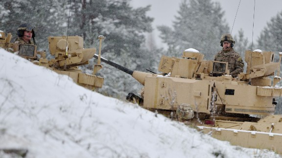 Latvian soldiers take part in live-fire exercises at the Adazi military base outside Riga, Latvia, on December 9, 2014.