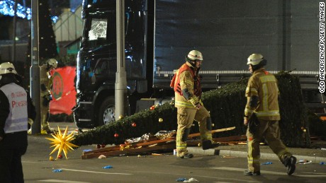 A Christmas tree lies next to a truck that slammed into a Christmas market at Gedächniskirche church.
