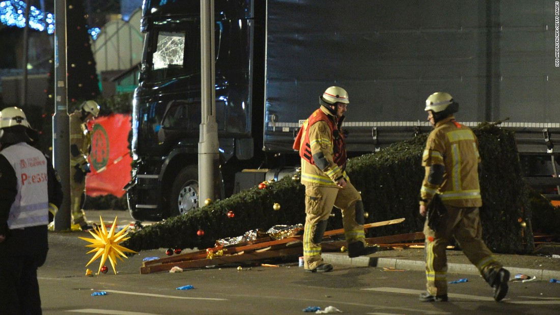 A Christmas tree lies next to the truck.