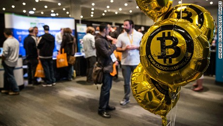 People attend a Bitcoin conference in New York.