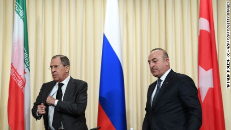 Russian Foreign Minister Sergei Lavrov (L) and his Turkish counterpart Mevlut Cavusoglu leave after a news conference in Moscow on December 20, 2016.   The foreign and defence ministers of Russia, Turkey and Iran are meeting in Moscow for key talks on the conflict in Syria. Iran and Russia are sharing a base in war-torn Syria to help coordinate their support for President Bashar al-Assad's forces, a top security official in Tehran said on December 20.   / AFP / Natalia KOLESNIKOVA        (Photo credit should read NATALIA KOLESNIKOVA/AFP/Getty Images)