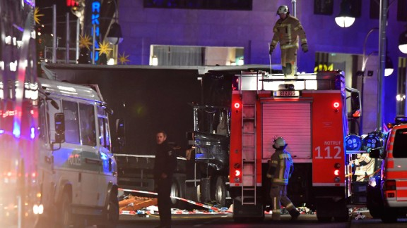 Witnesses describe moment a truck plowed through a Berlin Christmas market, killing 12 people.