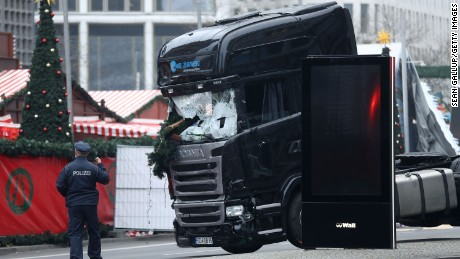 BERLIN, GERMANY - DECEMBER 20:  Rescue workers begin to remove the cab of the lorry the morning after it ploughed through a Christmas market on December 20, 2016 in Berlin, Germany. Several people have died while dozens have been injured as police investigate the attack at a market outside the Kaiser Wilhelm Memorial Church on the Kurfuerstendamm and whether it is linked to a terrorist plot.  (Photo by Sean Gallup/Getty Images)