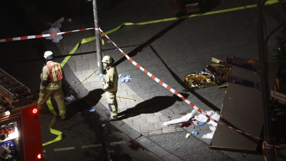 Authorites inspect a truck that sped into a Christmas market in Berlin.