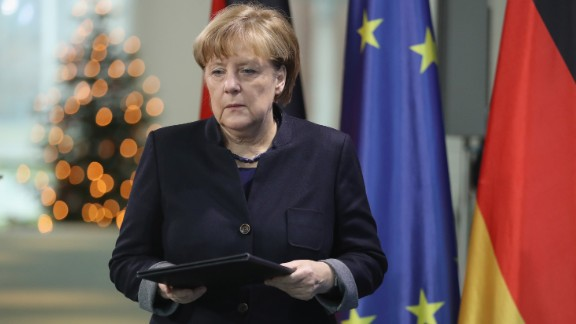 BERLIN, GERMANY - DECEMBER 20:  German Chancellor Angela Merkel arrives to give a statement the day after a man drove a truck into a crowded Christmas market on December 20, 2016 in Berlin, Germany. The man, whom police apprehended and have identified as a Pakistani national, drove the heavy truck into the Christmas market in the city center, killing 12 people and injuring 48.  (Photo by Sean Gallup/Getty Images)