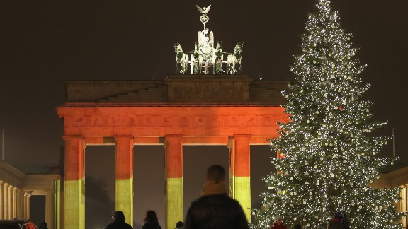 BERLIN, GERMANY - DECEMBER 20:  The Brandenburg Gate stands illuminated in the colors of the German flag the day before a truck drove into a crowded Christmas market in the city center on December 20, 2016 in Berlin, Germany. So far 12 people are confirmed dead and 45 injured. Authorities have confirmed they believe the incident was an attack and have arrested a Pakistani man who they believe was the driver of the truck and who had fled immediately after the attack. Among the dead are a Polish man who was found on the passenger seat of the truck. Police are investigating the possibility that the truck, which belongs to a Polish trucking company, was stolen yesterday morning.  (Photo by Sean Gallup/Getty Images)