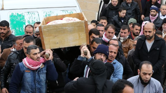 Jordanian mourners carry the coffin of Ibrahim Bashbsha, a day after he died in the attack.