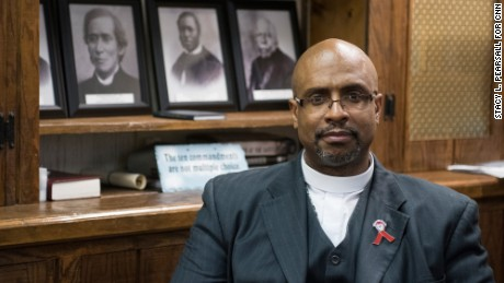 The Rev. Eric S. C. Manning, pastor of Emanuel African Methodist Episcopal Church, sits in his office