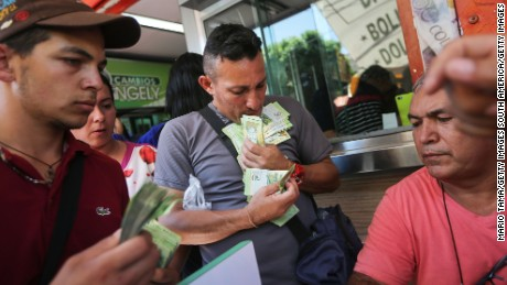 CUCUTA, COLOMBIA - OCTOBER 04:  Venezuelans exchange bolivars, the currency of Venezuela, into Colombian pesos in order to purchase Colombian goods on October 4, 2016 in Cucuta, Colombia. Inflation is one of many serious problems Venezuelans face. The dire economic crisis in Venezuela sends thousands of Venezuelans daily across the international border bridge to Cucuta, Colombia, to purchase food, medicine and other desperately needed supplies. UN Secretary General Ban Ki-moon has called the situation in Venezuela a 'humanitarian crisis'.  (Photo by Mario Tama/Getty Images)