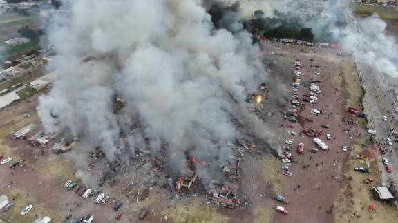 An image captured by a drone shows smoke billowing from the market after a series of blasts Tuesday.