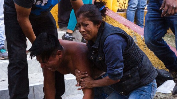 Relatives react near the body of a victim killed in the explosion.