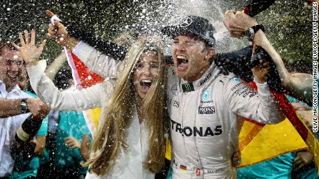 ABU DHABI, UNITED ARAB EMIRATES - NOVEMBER 27:  Nico Rosberg of Germany and Mercedes GP celebrates with his wife Vivian Sibold and his team after finishing second and securing the F1 World Drivers Championship at the Abu Dhabi Formula One Grand Prix at Yas Marina Circuit on November 27, 2016 in Abu Dhabi, United Arab Emirates.  (Photo by Clive Mason/Getty Images)