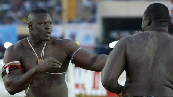 "Dakar, SENEGAL:  Senegalese wrestler Mohamed Ndao, aka Tyson (L) views with Yakhya Diop (130kgs), aka ""Yekini"", 02 January 2005 at Leopold Sedar Senghor stadium in Dakar. Yekini won over Mohamed Ndao. AFP PHOTO SEYLLOU  (Photo credit should read SEYLLOU/AFP/Getty Images)"