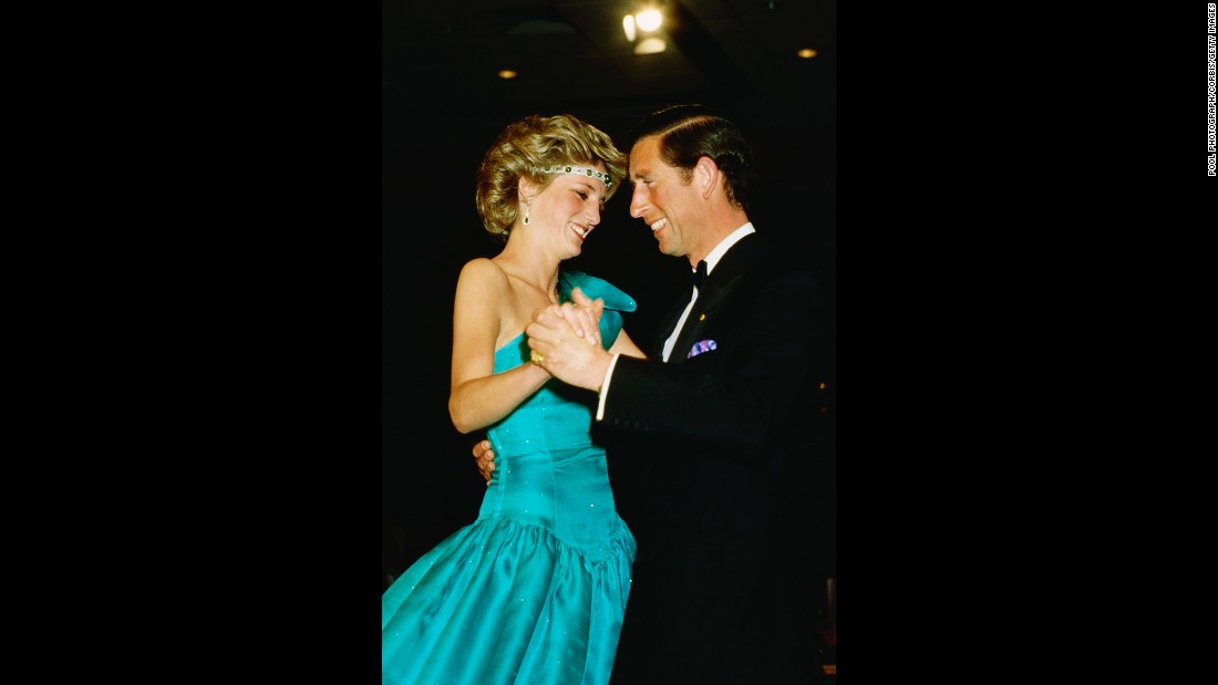 Charles and Diana dance together at a formal event.
