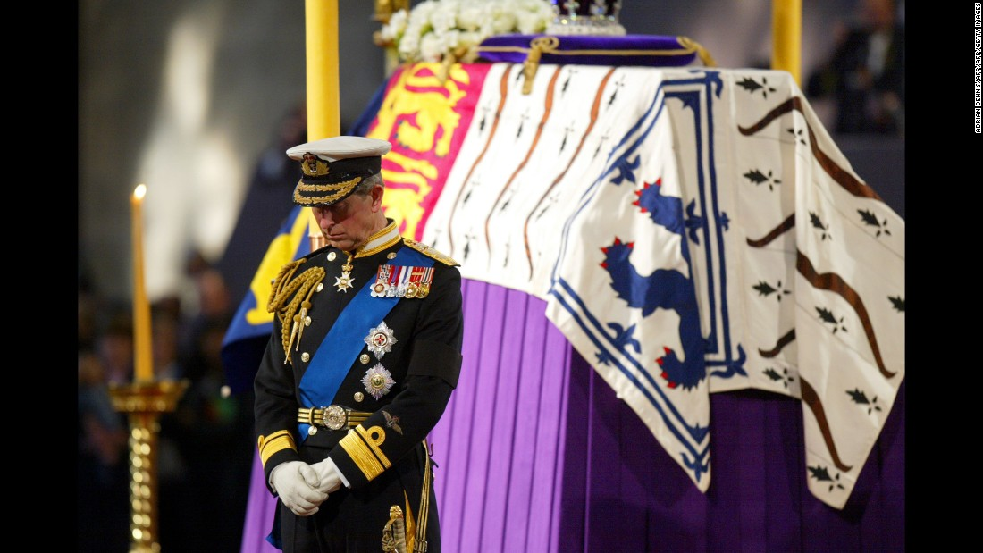 Prince Charles stands beside his grandmother's coffin while it lies in state at Westminster Hall in London in April 2002.