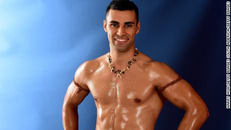 RIO DE JANEIRO, BRAZIL - AUGUST 08:  (BROADCAST - OUT) Pita Taufatofua of Tonga poses for a photo on the NBC Today show set at Copacabana Beach on August 8, 2016 in Rio de Janeiro, Brazil.  (Photo by Harry How/Getty Images)