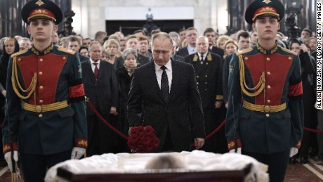 Russian President Vladimir Putin pays his respects to slain Russian Ambassador to Turkey Andrei Karlov, during the funeral ceremony at the Russian Foreign Ministry in Moscow on December 22, 2016. Russian President Vladimir Putin on December 22 bade farewell to Andrei Karlov at a packed memorial ceremony in Moscow for the diplomat who was assassinated in Turkey by an off-duty policeman. / AFP / SPUTNIK / ALEXEI NIKOLSKY        (Photo credit should read ALEXEI NIKOLSKY/AFP/Getty Images)