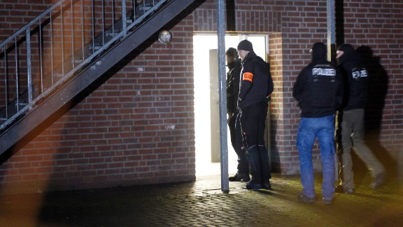 Police officers enter a refugee shelter Thursday in Emmerich, Germany.