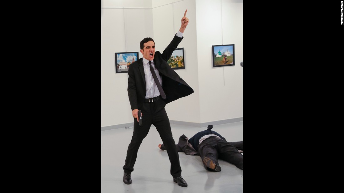 "A gunman gestures after <a href=""http://www.cnn.com/2016/12/19/middleeast/gallery/andrey-karlov-shooting/index.html"" target=""_blank"">assassinating Andrey Karlov,</a> the Russian ambassador to Turkey, at a photo exhibition in Ankara, Turkey, on Monday, December 19. Turkish Interior Minister Suleyman Soylu said the gunman was Mevlut Mert Altintas, a Turkish police officer. In a video circulating on social media, the shooter was heard shouting, ""Allahu akbar (God is greatest). Do not forget Aleppo! Do not forget Syria! Do not forget Aleppo! Do not forget Syria!"" Russia is the most powerful ally of the Syrian regime and has carried out airstrikes to prop up embattled leader Bashar al-Assad. Karlov, 62, <a href=""http://www.cnn.com/2016/12/19/europe/who-was-andrey-karlov/"" target=""_blank"">had served in Ankara</a> since July 2013."