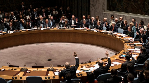 Secretary of State John Kerry (R) leads a security council resolution on the situation in Syria on December 18, 2015 at United Nations Headquarters in New York City.