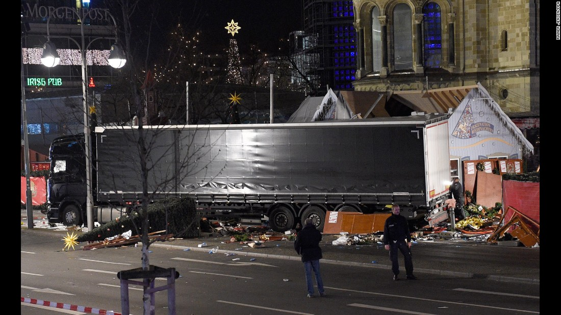 "Authorities examine a truck that <a href=""http://www.cnn.com/2016/12/19/europe/gallery/berlin-market-attack/index.html"" target=""_blank"">crashed into a crowded Christmas market in Berlin</a> on Monday, December 19. At least 12 people were killed and 48 injured in what police are investigating as a terrorist attack."