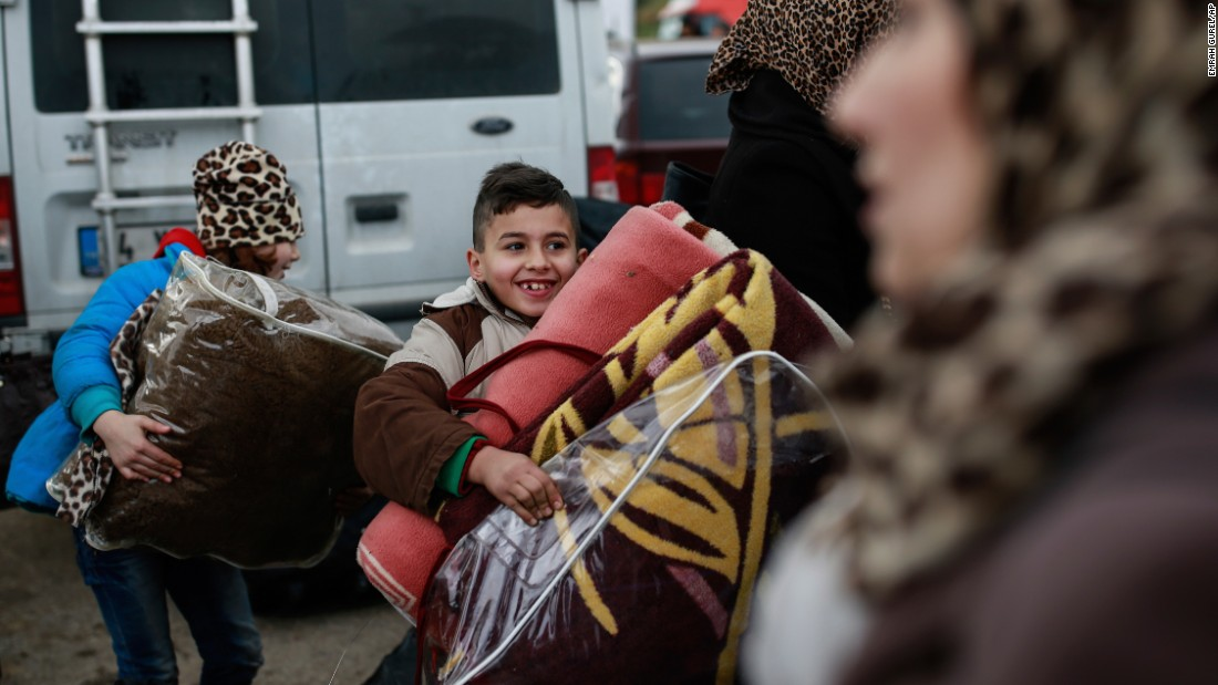 "Zein, a boy from Idlib, Syria, looks for his family members after crossing into Turkey on Saturday, December 17. Idlib <a href=""http://www.cnn.com/2016/12/15/middleeast/aleppo-syria-government-gains/"" target=""_blank"">could be the next major war zone in Syria</a> after the <a href=""http://www.cnn.com/2016/12/13/middleeast/gallery/battle-for-aleppo/index.html"" target=""_blank"">battle for Aleppo</a> ends. Idlib is one of the few remaining footholds that rebel groups still have in the country."