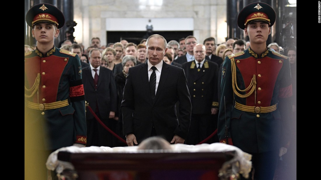 "Russian President Vladimir Putin, center, attends a farewell ceremony for <a href=""http://www.cnn.com/2016/12/19/europe/who-was-andrey-karlov/"" target=""_blank"">Andrey Karlov,</a> the Russian ambassador to Turkey, on Thursday, December 22. Karlov, 62, was assassinated while attending a photo exhibit in Ankara, Turkey. He is survived by a wife and son, according to the Russian Embassy."