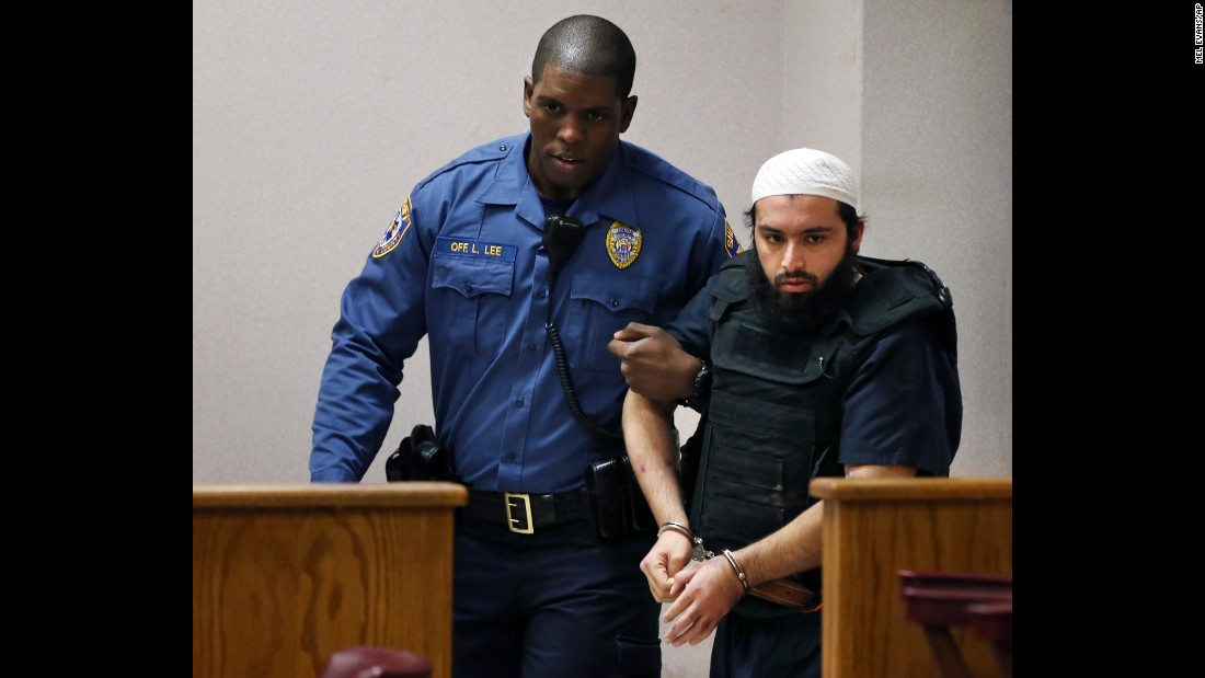 "Ahmad Khan Rahimi, the man accused of setting off bombs in New Jersey and New York in September, is led into court Tuesday, December 20, in Elizabeth, New Jersey. Through his attorney, <a href=""http://www.cnn.com/2016/12/20/us/ny-nj-bomber-pleads-not-guilty-state-charges/"" target=""_blank"">he pleaded not guilty</a> to charges connected with the police shootout that led to his capture."