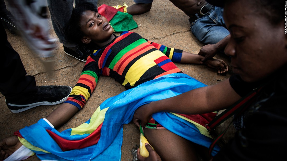 A protester lies on the ground in Pretoria, Congo, after police fired rubber bullets on those protesting President Joseph Kabila on Tuesday, December 20.