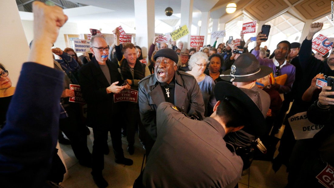 "The Rev. Kojo Nantambu, center, was among at least 39 protesters who were arrested at North Carolina's Legislative Building on Friday, December 16. Hundreds were at the building to protest a Republican ""power grab,"" <a href=""http://www.newsobserver.com/news/politics-government/state-politics/article121302433.html"" target=""_blank"">according to The News & Observer</a> in Raleigh. The GOP-controlled General Assembly <a href=""http://www.cnn.com/2016/12/20/politics/north-carolina-power-grab/"" target=""_blank"">passed two pieces of legislation</a> that stripped duties from Republican Gov. Pat McCrory so that the power of his successor, Democratic Attorney General Roy Cooper, would be curtailed. (Cooper defeated McCrory in November.) McCrory said in a statement that the laws were ""hardly extreme changes"" and intended to fix a ""broken election process"" and ""enhance"" education policies."