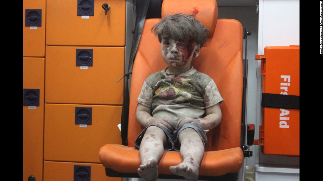 "Wounded 5-year-old <a href=""http://www.cnn.com/2016/08/17/world/syria-little-boy-airstrike-victim/"" target=""_blank"">Omran Daqneesh</a> sits alone in the back of an ambulance after he was injured during a Russian or Assad regime forces airstrike targeting the Qaterji neighborhood of Aleppo on August 17, 2016."